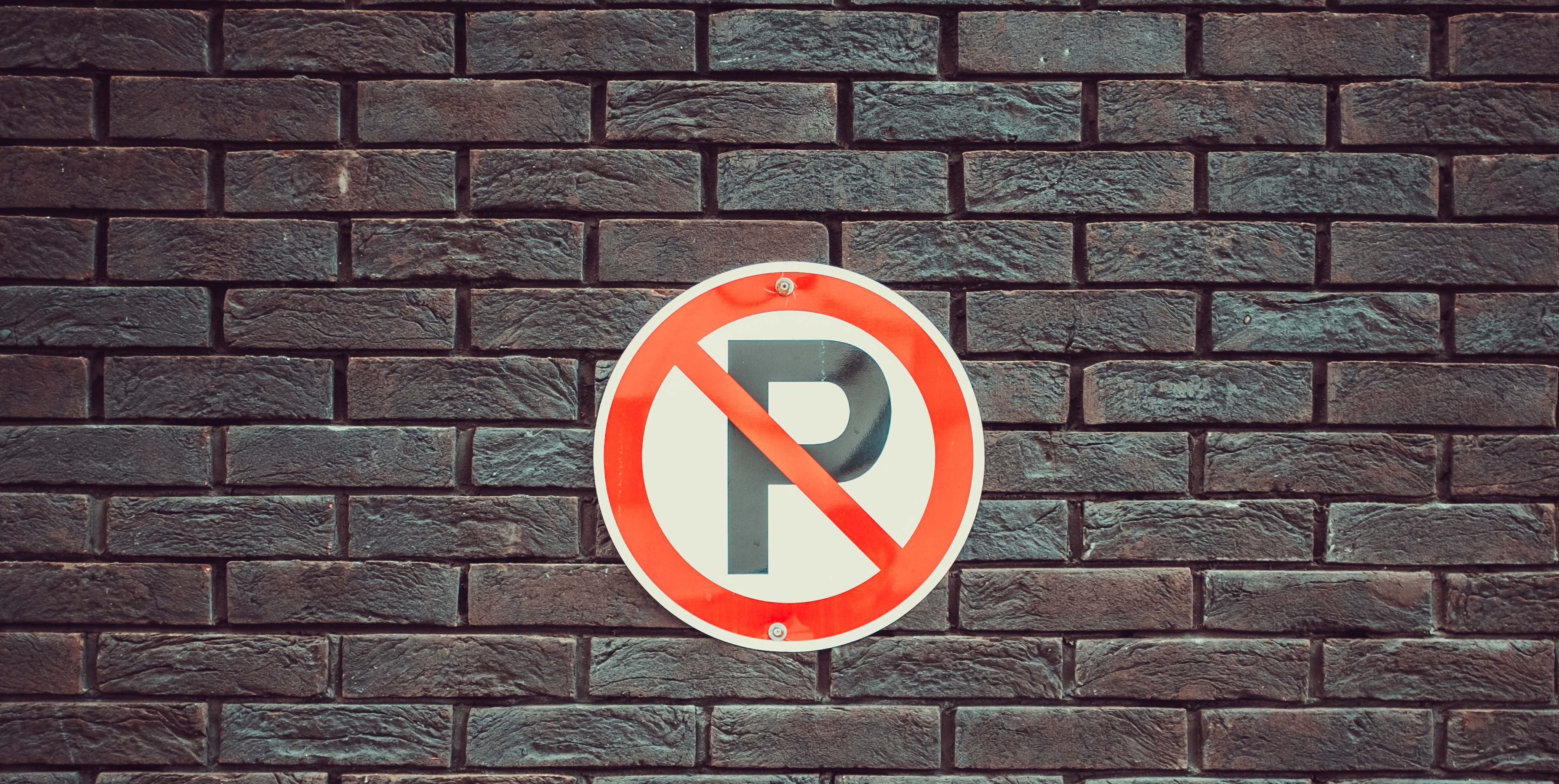 Parking signboard on a wall